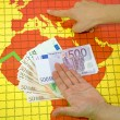 World economic crisis - money in hand — Stockfoto