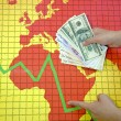 World economic crisis - money in hand — Stock Photo