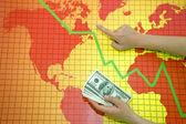 World economic crisis - money in hand — Stock Photo