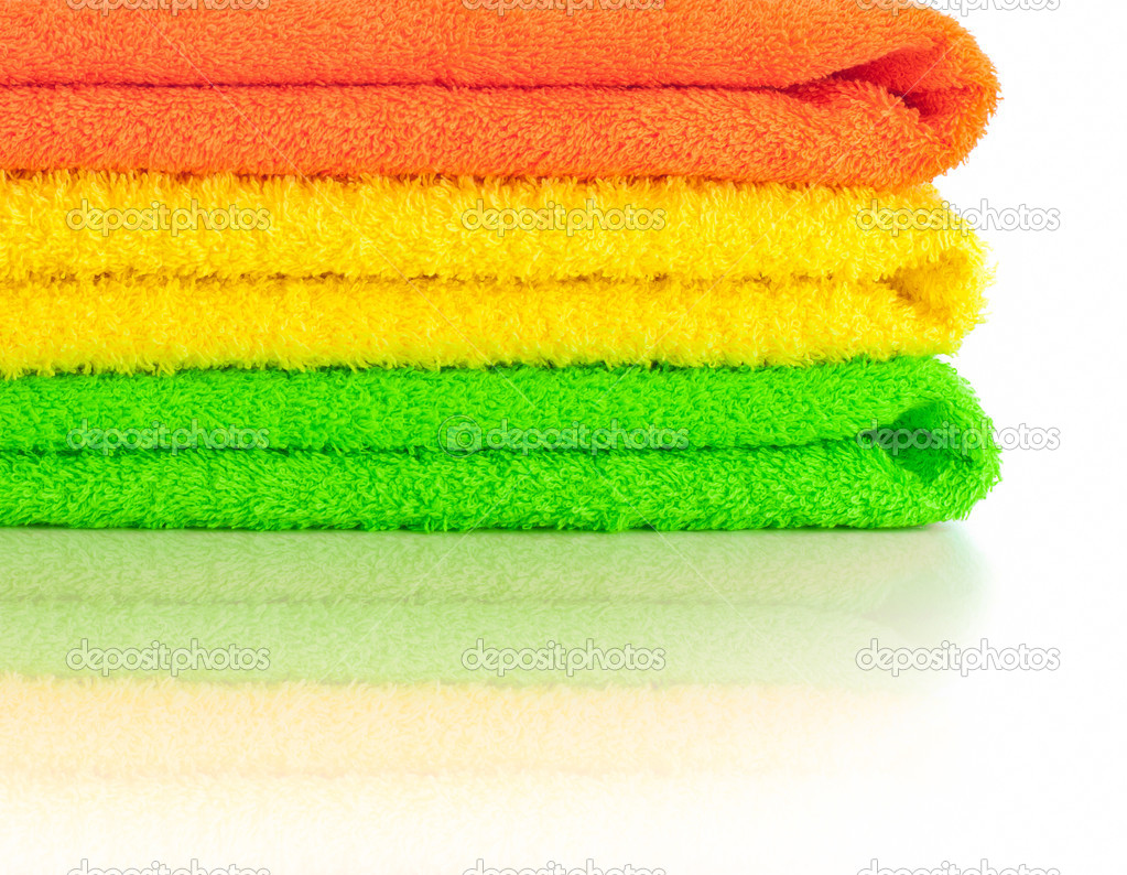 Stack Of Fresh Colorful Towels Isolated Stock Photo