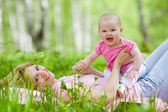 Mother and daughter in birch spring park — Stock Photo