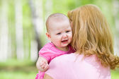 Crying or upset girl with mother outdoor — Stock Photo