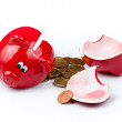 Broken piggy bank or money box with coins isolated on white — Stock Photo