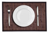 Bamboo placemat with plate fork and knife isolated on white — Stock Photo