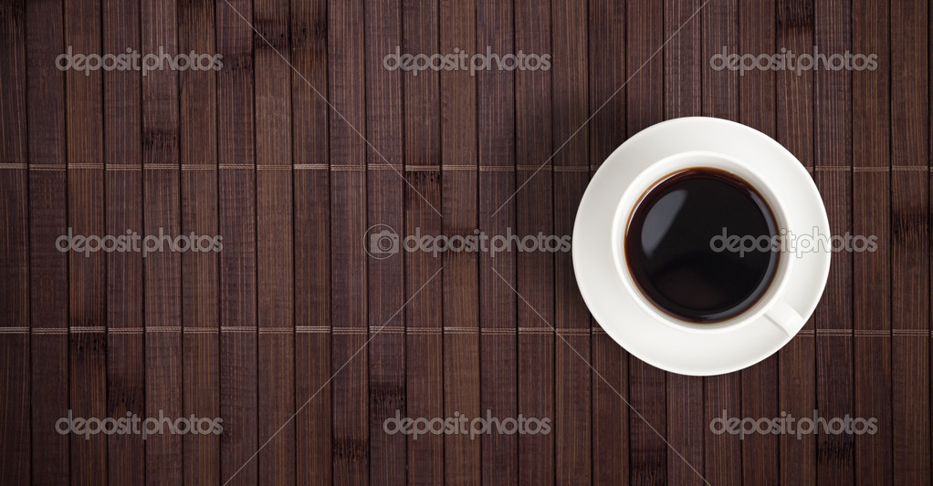 Coffee cup top view on bamboo table — Stock Photo #6870706