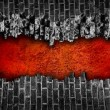 Broken black brick wall  with large red hole — Stock Photo