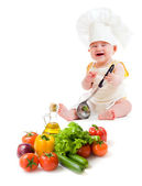 Funny baby boy preparing healthy food isolated — Stock Photo