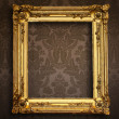 Stock Photo: Empty golden painting frame on vintage wallpaper