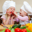 Two little girls preparing healthy food on kitchen - Stock Photo