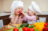 Two little girls preparing healthy food on kitchen — Stock Photo