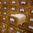 Old wooden card catalogue with one opened drawer — Stock Photo #7242913
