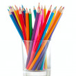 Color pencils pile in glass isolated — Stock Photo