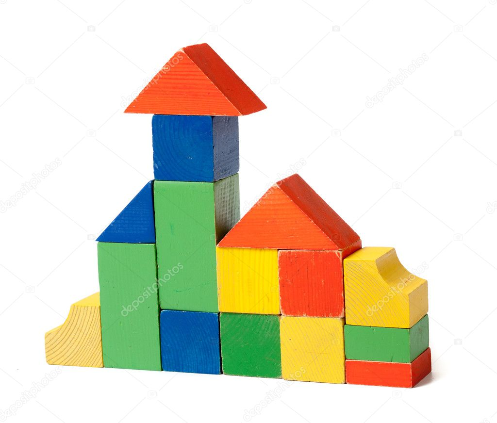 Simple house made from colorful wooden building blocks — Stock Photo #7328119
