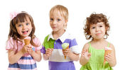 Happy children with ice cream in studio isolated — Stock Photo