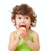 Little curly girl with ice cream in studio isolated — Stok fotoğraf
