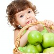 Adorable little girl with green apples in basket isolated studio — 图库照片