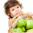 Adorable little girl with green apples in basket isolated studio — ストック写真