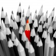 Leadership concept - bunch of gray pencils with red one - Stock Photo