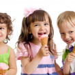 Stock Photo: Happy children with ice cream in studio isolated