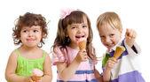 Happy children with ice cream in studio isolated — Stock Photo