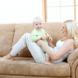 Happy son and mother playing on sofa — Stock Photo