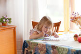 Little girl painting picture with watercolour — Stock Photo