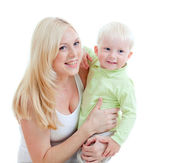 Happy adorable mother taking her child in arms. Studio shot iso — Stock Photo