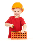 Boy in hard hat with trowel and brick isolated — Stock Photo