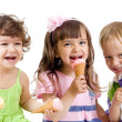 Happy children group with ice cream in studio isolated — Stock Photo #7597341