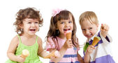 Happy children group with ice cream in studio isolated — Stock Photo