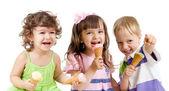 Happy children group with ice cream in studio isolated — Stock Photo