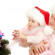 Father helps daughter decorate Christmas tree — Stock Photo #7681276