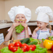 Stock Photo: Two little girls preparing healthy food and have fun on kitchen