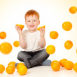 Redheaded boy with falling oranges — Stock Photo #7925118