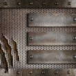 Stock Photo: Three rusty plates over metal holed or perforated grid backgroun