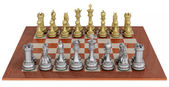 Metal chess set on wooden board — Stock Photo