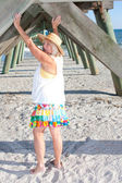 Woman Playing Under The Pier — Foto de Stock