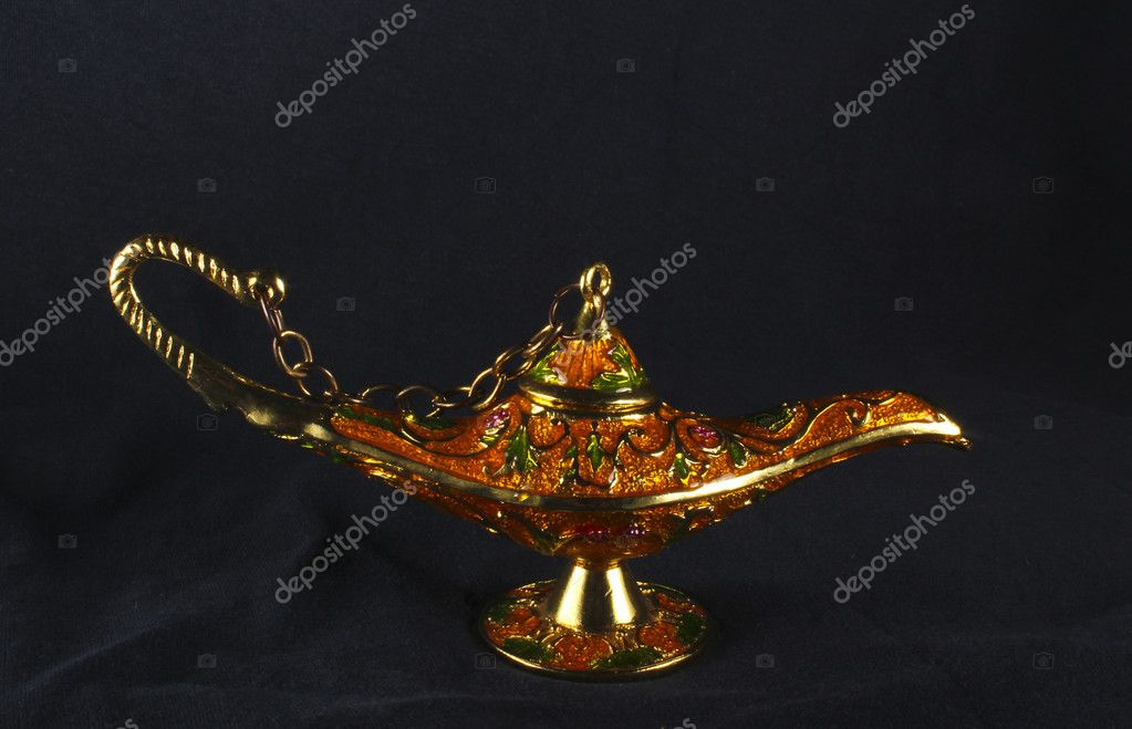 Colorful genie lamp, also called Aladdin lamp - on black background — Stock Photo #7098139