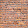 Red brick wall with gutter pipe — Stock Photo