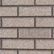 Fake grey brick wall siding — Stock Photo