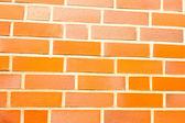 Fake ocher brick wall siding — Stock Photo