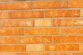 Falešné okr cihlová zeď obklady — Stock fotografie