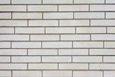 Fake grey brick wall siding — Stock Photo