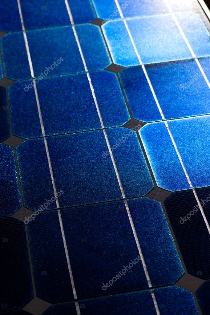 Pattern of solar cell wafers in photovoltaic solar panel with sun glare. — Stock Photo #6822082