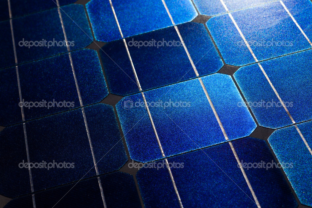 Pattern of solar cell wafers in photovoltaic solar panel with sun glare. — Stock Photo #6822107