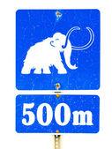 Funny mammoth symbol on road sign — Zdjęcie stockowe