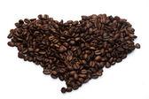 Heap of coffee crops in heart shape — Stock Photo