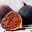 Two and a half fresh figs — Stock Photo #7352802