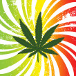 Rasta background with marijuana leaf — Stock Photo
