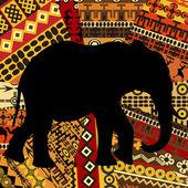 Elephant silhouette on ethnic textures background — Stock Photo